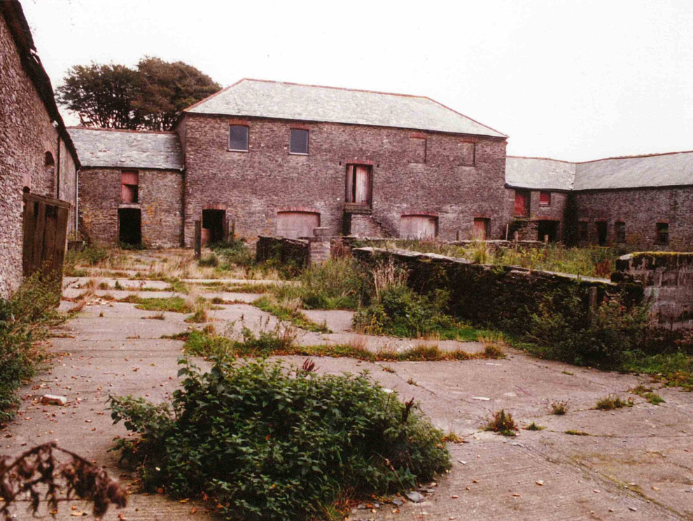 View of Victorian abandoned farm yard in Devon and building before being renovated