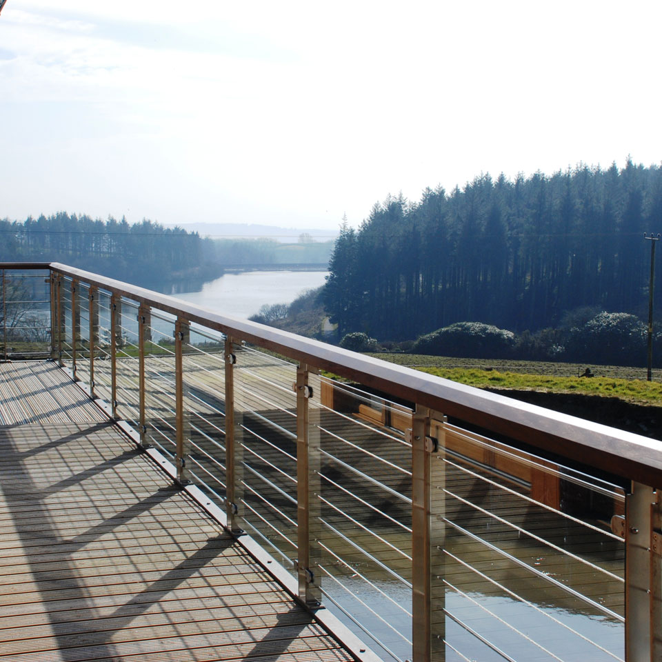 View from decked veranda overlooking water and trees