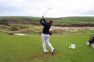 Man playing golf, doing a swing