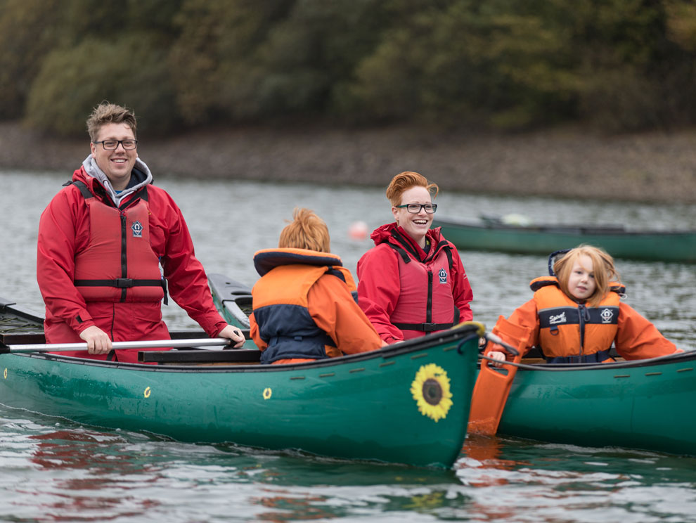 Family of four in canoes at Calvert Trust Exmoor