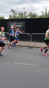Runners during the 2019 London Marathon, one runner waving at camera