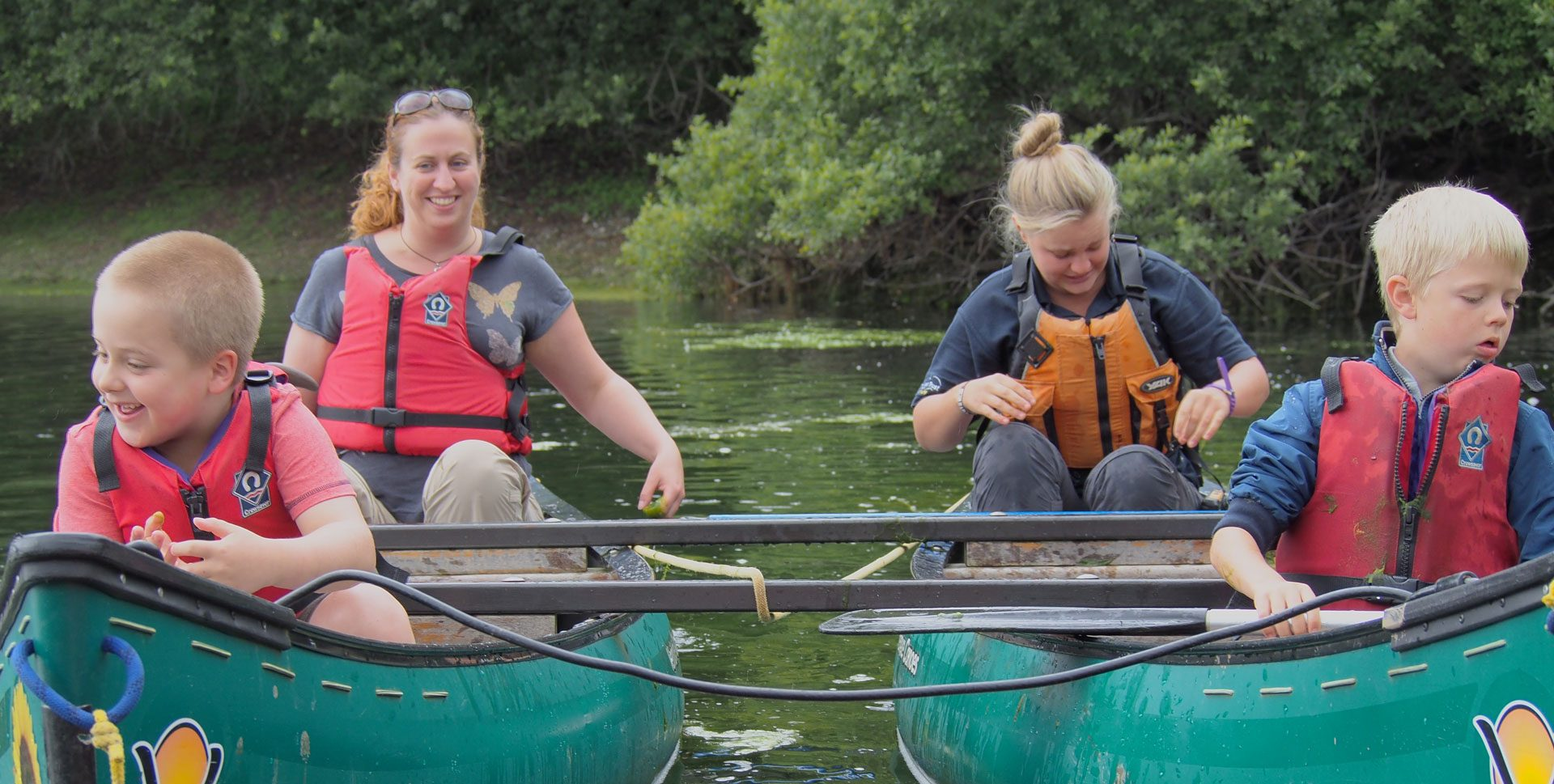 Calvert Trust Exmoor guests in tandem canoes on water