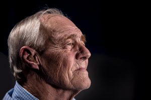 A man with a hearing aid.