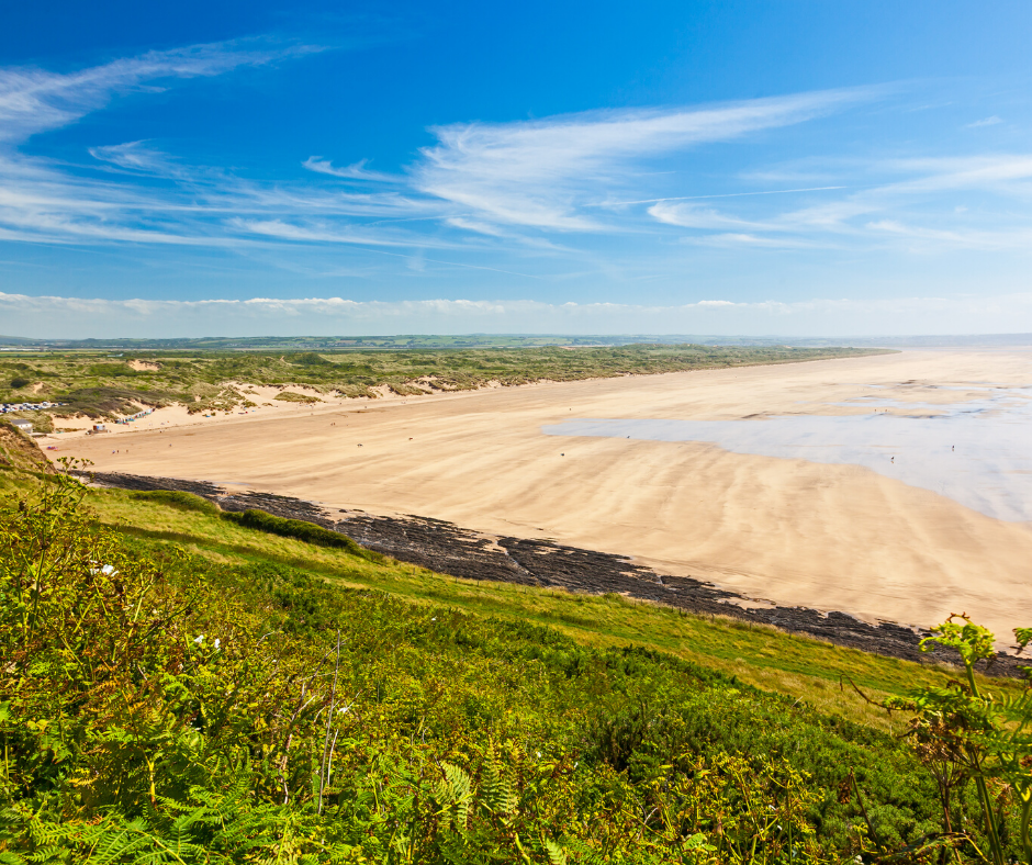 A view of Saunton beach from the side of a hill with the sands stretching in the background