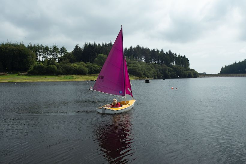 A guest on a boat on the reservoir at Calvert Trust Exmoor