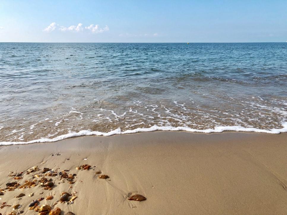 Gentle sea waves on sand
