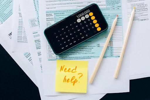 A calculator on top of bills