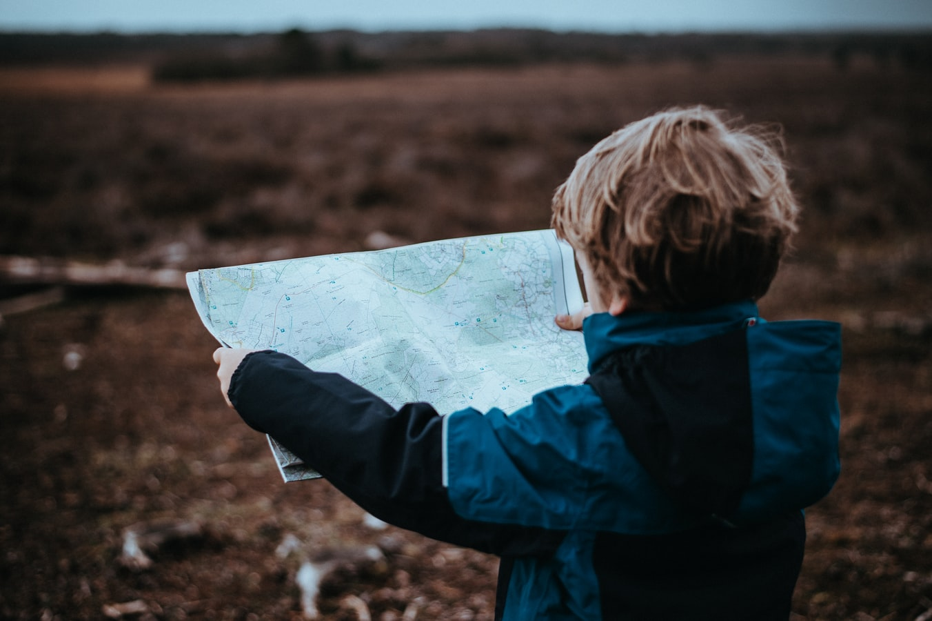 A young child looking at a map